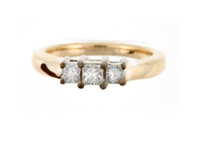 Three stone princess diamond engagement ring in yellow gold.