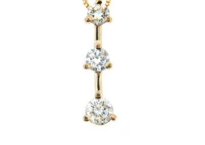 3 Stone diamond pendant in yellow gold.