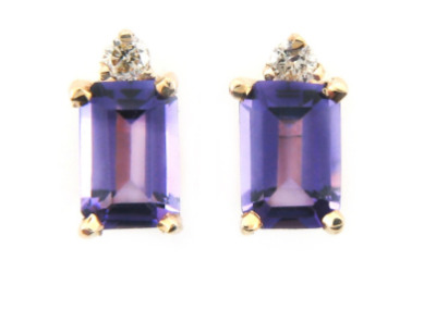 Emerald cut amethyst and diamond earring in yellow gold.
