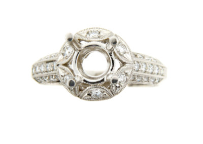 Antique style engagement ring setting with pavé set side stones in platinum.