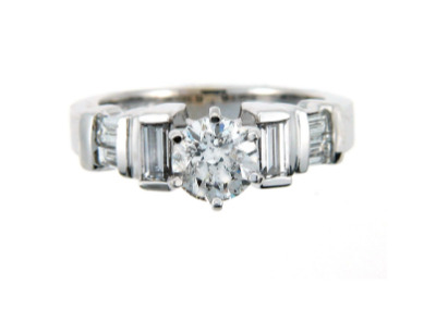 Brilliant cut diamond engagement ring with side stones in white gold.