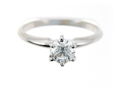 Brilliant cut solitaire diamond engagement ring in white gold.