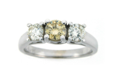 Canary diamond engagement ring with side stones in white gold.