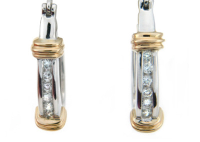 Channel set diamond dangle earrings in white gold.