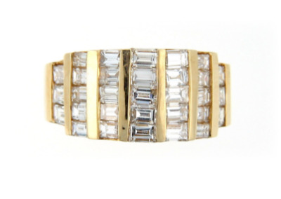 Channel set diamond anniversary band in yellow gold.