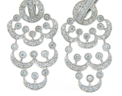 Pavé set diamond chandelier earrings.