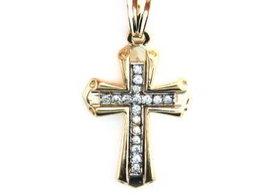 Diamond cross pendant in yellow gold.