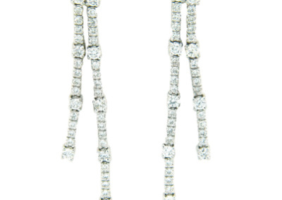 Diamond dangle earrings in white gold.