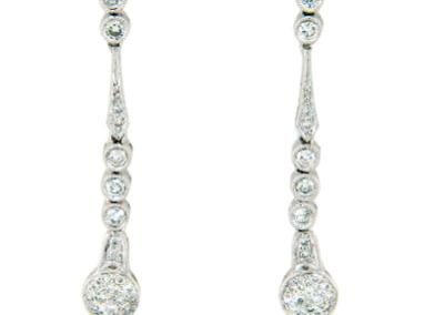 Diamond dangle earrings in white gold.