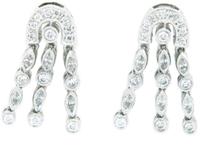 Pavé set diamond dangle earrings in white gold.