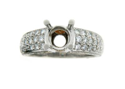Round diamond semi-mounting in platinum with pavé set side diamonds.