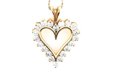 Diamond heart pendant in yellow gold.
