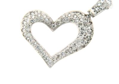 Pavé set diamond heart pendant in white gold.