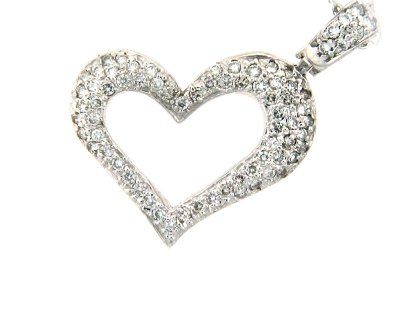 Pavé set diamond heart pendant in white gold.
