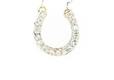 Diamond horseshoe pendant in white gold.