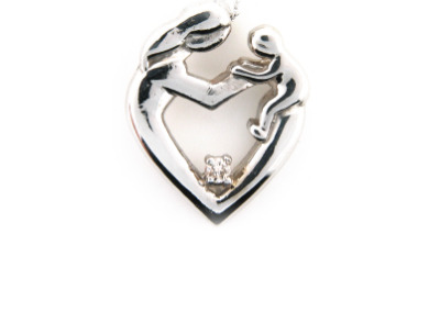 Diamond mother and child pendant in white gold.