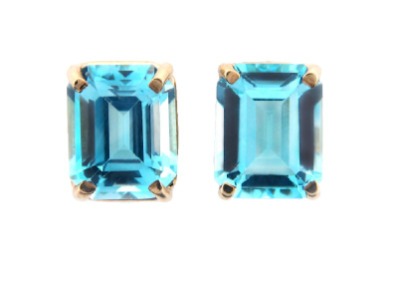 Emerald cut blue topaz earrings in yellow gold.