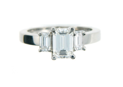 Emerald cut diamond engagement ring in white gold.