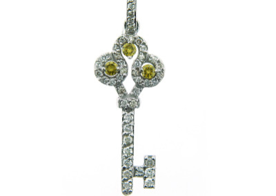 Key pendant with white diamonds and canary diamonds.
