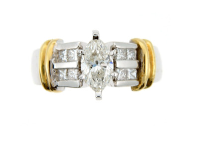 Marquise diamond engagement ring in yellow and white gold.