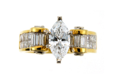 Marquise diamond engagement ring in yellow gold.
