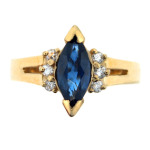 Marquise sapphire and diamond ring in yellow gold.