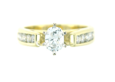 Oval diamond engagement ring in yellow gold.