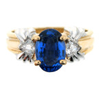 Oval sapphire and diamond ring in white and yellow gold.