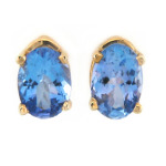 Oval cut blue topaz earrings in yellow gold.