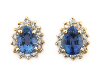 Pear cut sapphire and diamond earrings in yellow gold.