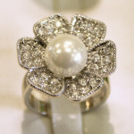 White pearl flower ring.