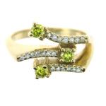 Peridot and diamond ring in yellow gold.