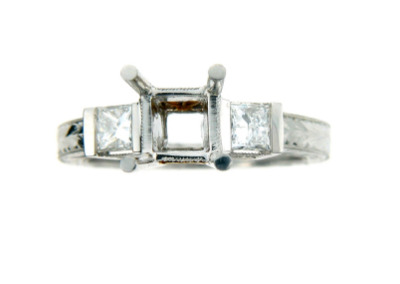 Princess cut engagement ring setting in white gold.