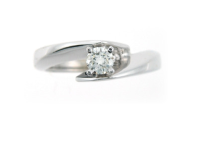 Round brilliant cut contemporary engagement ring in white gold.