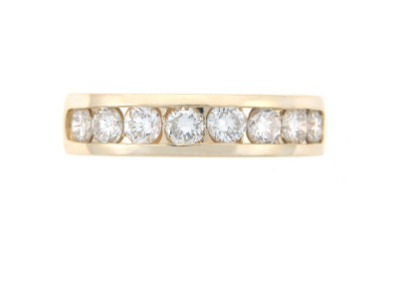 Round brilliant cut diamond anniversary band in yellow gold.