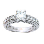 Round brilliant cut diamond engagement ring with pavé set side stones in white gold