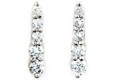 Round brilliant cut diamond journey earrings in white gold.