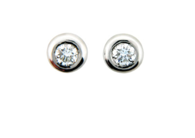 Round bezel set diamond stud earring in platinum.