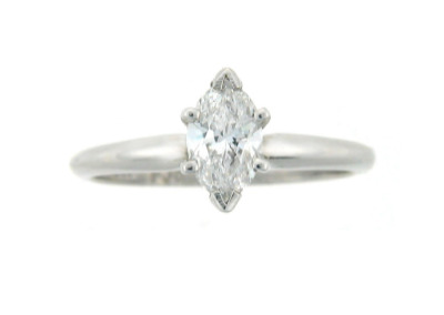 Solitaire marquis diamond engagement ring in white gold.