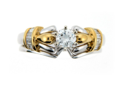Brilliant cut diamond ring in white and yellow gold.