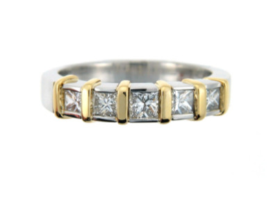 Princess cut diamond anniversary band in platinum and yellow gold.