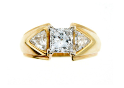 Yellow gold princess cut diamond engagement ring in white gold.